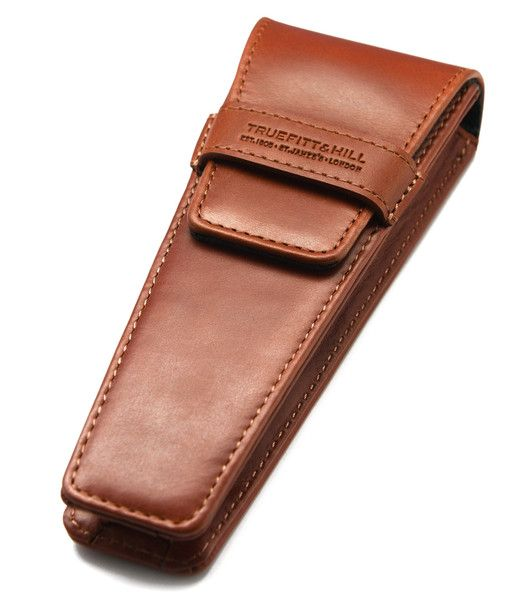 Razor Travel Holder. This protective leather travel holder is the best way to protect your razor whilst on the move. Available in three colors (tan black and green). Dimensions: Width - 6.5cm, Depth 3.5cm(when closed), Height - 15cm.