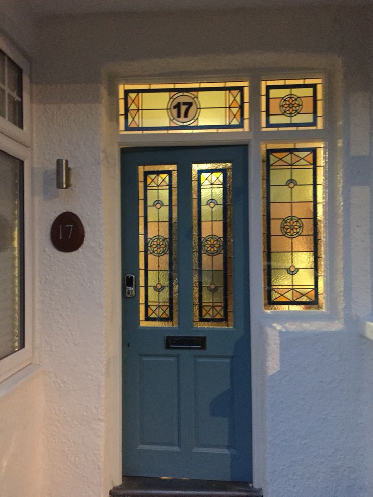 Stain Glass Front Door! Door is Farrow & Ball Stone Blue. Walls are Dulux Jasmine White.