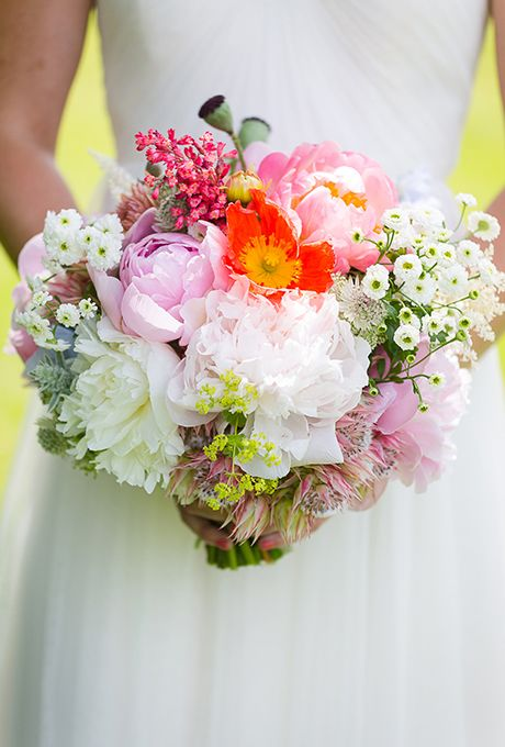 Brides.com: . Bouquet of peonies, poppies, feverfew, blushing bride proteas, ladies mantle, and poppy pods, $350, Erin Ostreicher Designs