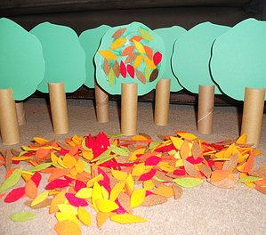 Tried and Test Toddler Group Craft - Autumn Craft - Sticking Felt Autumn Leaves on Trees... Tree trunks made out of thick roll with slit cut into it. Very popular. Autumn 2013