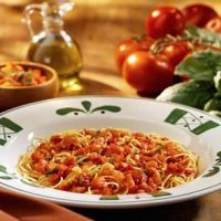Olive Garden's Capellini Pomodoro  Ingredients  3 cloves garlic, minced  2 lbs. plum tomatoes; seeded, diced  1 oz. fresh basil leaves, minced  1/3 C. extra virgin olive oil  3 oz. parmesan cheese  12 oz. dry angel hair pasta, cooked  1/4 tsp. pepper