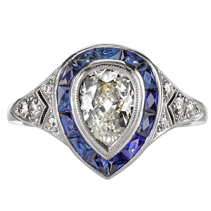 Pear Shape Diamond and Sapphire Engagement Ring  | From a unique collection of vintage engagement rings at https://www.1stdibs.com/jewelry/rings/engagement-rings/