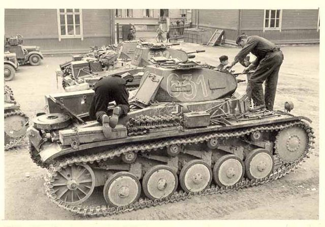 Crew members working on their Panzer 2