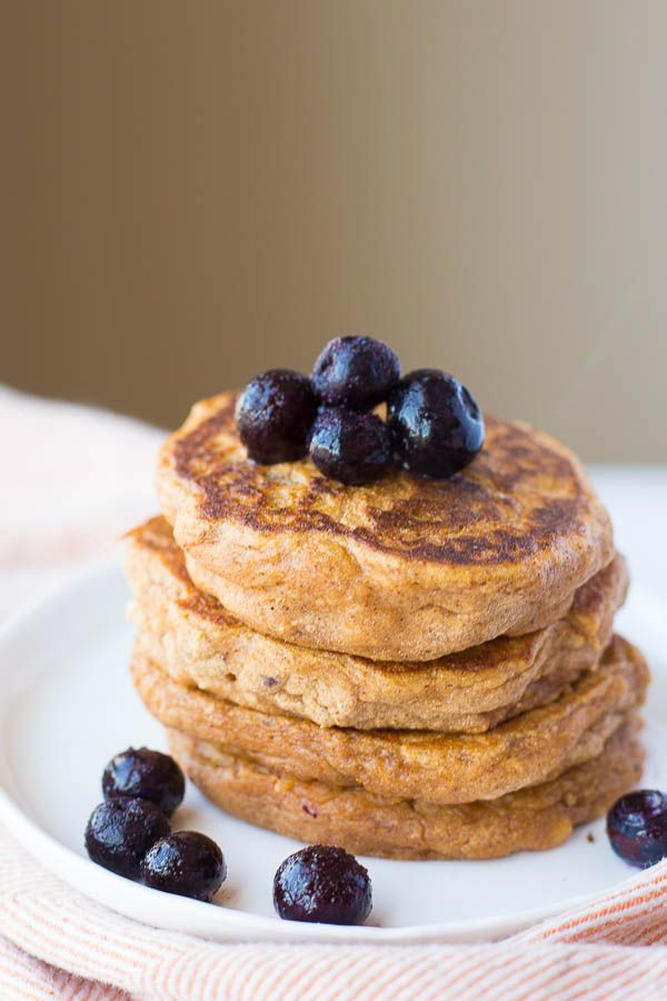 Sweet Potato Pancakes with Peanut Butter Maple Syrup: These gluten free and vegan pancakes are ultra fluffy and tender! Made from healthy, whole food ingredients, these pancakes are the perfect breakfast or brunch! || fooduzzi.com recipe