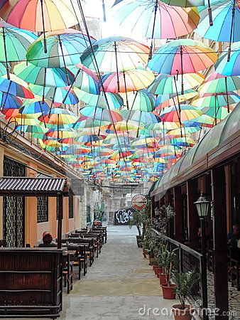 Victoria Passage in Bucharest is decorated with many colorful umbrellas.