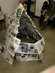 Building a structure without talking from masking tape and newspaper Family Volley: FAMILY FUN FRIDAY-Survivor!