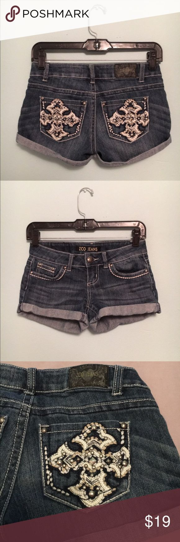 ZCO jean short shorts Like new ZCO Jeans brand shorts with studs and cross design on back pockets. Size 0.  #shorts #shortshorts #zcobrand #zcojeans #missme #missmejeans #missmeshorts  #thebuckle #buckle #bucklejeans #rustic #country ZCO Shorts Jean Shorts
