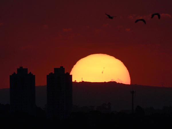 The source of the major solar storm was sunspot AR1302, which stretches about 93,000 miles (150,000 kilometers) from end to end and is visible to the naked eye, according to SpaceWeather.com.    Photographer Fabiano Belisário Diniz caught the monster sunspot in a picture he took of the sun setting over Curitiba, Brazil, on September 26.