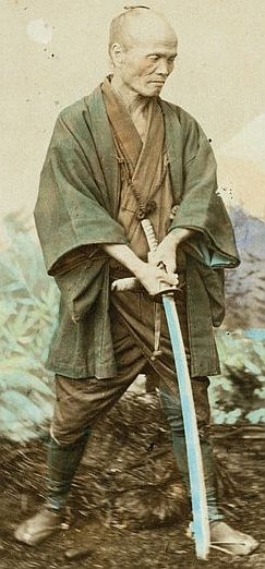 Samurai executioner, a well known old practitioner who by his own account had in a year when business was brisk a very tolerable income. He received some 7 ichiboos (about $2.30) per head, and had taken off as many as 350 heads in a twelve month period, his office, however was a despised one.