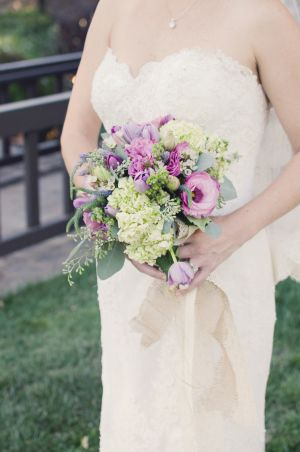 A striking yet easy on the eyes purple and green wedding bouquet!