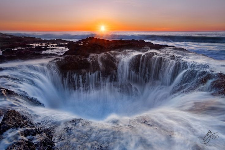 Thor's Well is a sink hole of Cape Perpetua, a forested area of land on the central Oregon Coast, surrounded by water on three sides. Thor's Well is also often simply called the Spouting Horn. It is essentially a huge salt water fountain operated by the Pacific Ocean's power. This natural spectacle is at its best when it's the most dangerous to watch - at high tide or during winter storms.