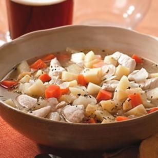"Autumn Chicken Stew - This simple chicken stew stars three of fall's best crops—apples, carrots and parsnips. Serve with toasted sharp Cheddar cheese sandwiches and a brown ale. ""Wouldn't change a thing. Served it with cold cider to drink and warmed organic canned peaches mixed with some allspice and served over ginger ice cream for dessert. Perfect autumn meal. Quick, easy and delicious."""