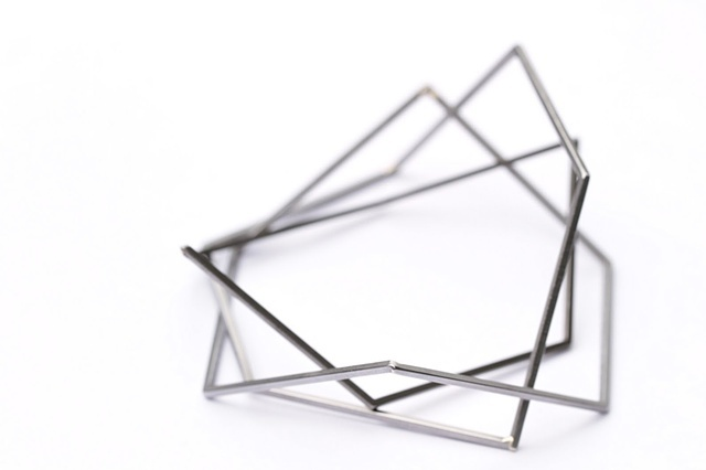 three steel hexagon bracelets