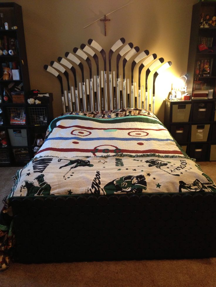 Complete hockey bed; stick headboard, puck footboard, arena quilt.