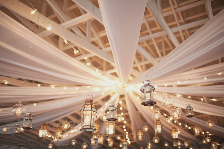 fabric draped ceiling with tons of lights..perfect