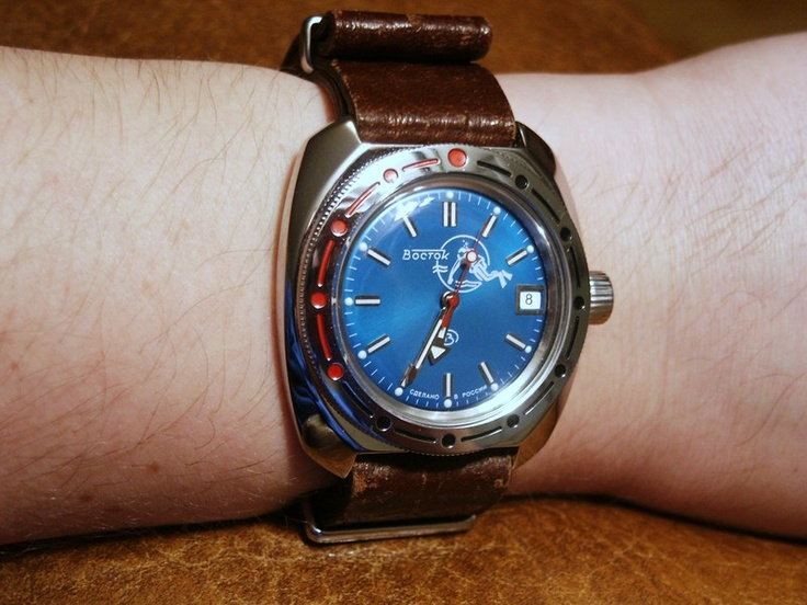 Vostok amphibia, blue scuba dude. cheaper than a Swatch but built like a tank. This is how they do their watches in soviet Russia.