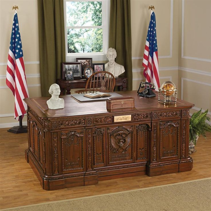 This historic desk is a replica of the one created from the timbers of the British H.M.S. Resolute, given to U.S. President Rutherford Hayes in 1880 by Queen Victoria and used by most American heads of State since. A presidential 6-feet in width, this solid mahogany masterwork features hand carving that includes a nothing-short-of-amazing American eagle on little John-John Kennedy's opening panel and an enviable, tooled antique brown leather top with gold tooling. This extraordinary Victo...