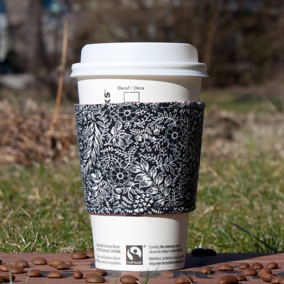 Black and white floral coffee cozy with hot pink lining