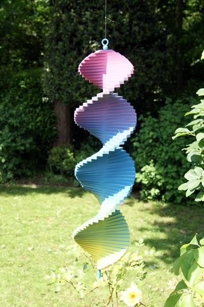 see - rainbow wooden wind spinner for a sensory garden - mesmerising!
