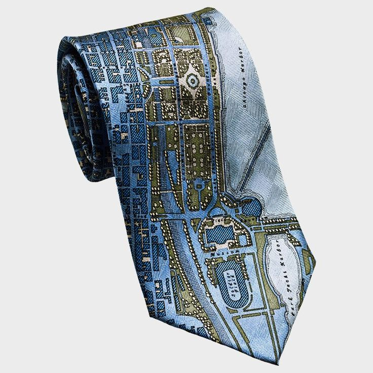 """City Necktie - Chicago Show your Chicago pride with these beautiful neckties.  The city plan tie stylishly portrays Chicago's waterfront, stretching from Soldier Field to Belmont Harbor.  The """"El"""" transit tie is printed with a generous swath of the Chicago transit system, stretching from Comiskey Park, at the end, to Loyola University, at the neck.  Ships in gift box.  Details Material: 100% silk Size: 56"""" long 3.25""""- 3.5"""" wide"""