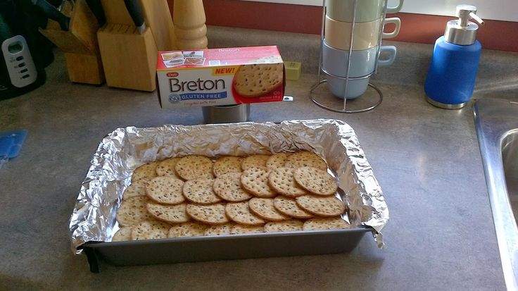 Breton Brittle- Breton crackers-1/2c butter-1/2c brn sugar, packed-1 sm pkg semi-sweet choc chips-1/3c chopped nuts. Line 9 x 13 cake pan with alum.foil, overlap crackers to cover bottom. Melt brn sugar & butter in a pan, stir often til it boils. Carefully pour over crackers. Bake 400°F/ 5 mins. Remove from oven & quickly scatter choc. chips over top. Let stand a few min, til softened. Spread chocolate evenly over crackers,sprinkle with nuts. Cool in fridge til hardened, break it into…