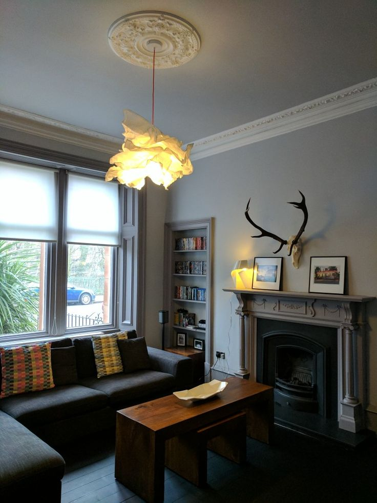 Grey living room. Antlers above fireplace, black fire, coloured cable. Walls in Dulux Engraved Locket and woodwork in Wishing Well