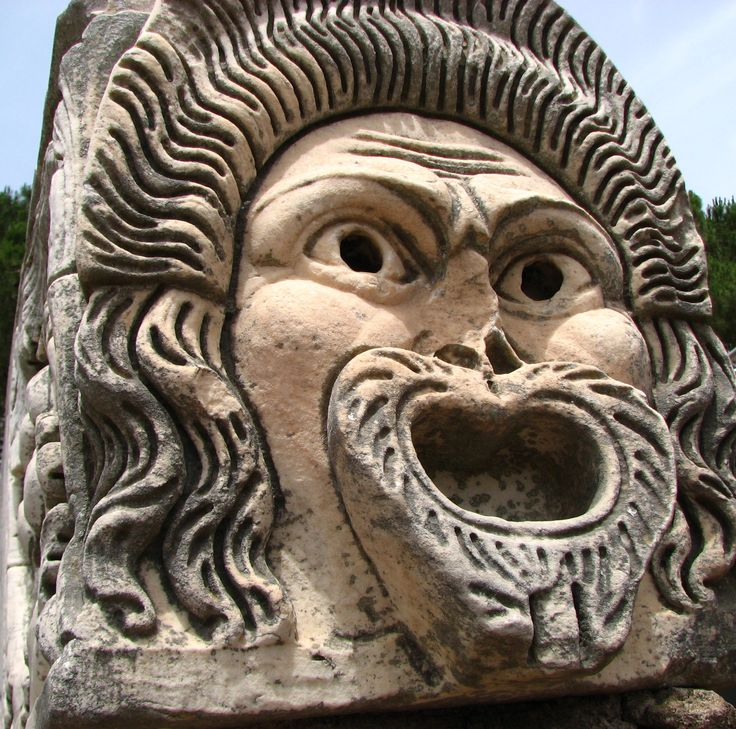 Theatrical mask, part of the architectural decoration of the theatre (regio II, insula VII). Ostia Antica, Rome, Italy.