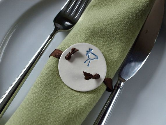 Do you like to entertain or do you like to have a little hostess gift on hand for a last minute dinner invite? These adorable ceramic napkin rings are perfect for you. These handmade 2 round creamy white ceramic disks have an impressed design and 2 holes for ribbon of your choice. The design is a funky bird and it is colored with a periwinkle blue glaze and a clear glaze over that. Your order will be lovingly wrapped in tissue secured with aqua and white string. It will come to you via…
