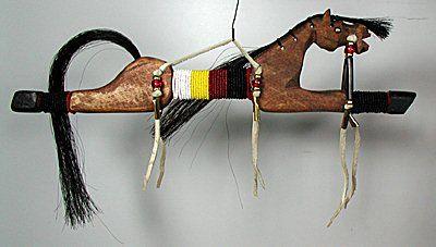 [Wall near chaise] Lakota Spirit Horse  Dance Stick