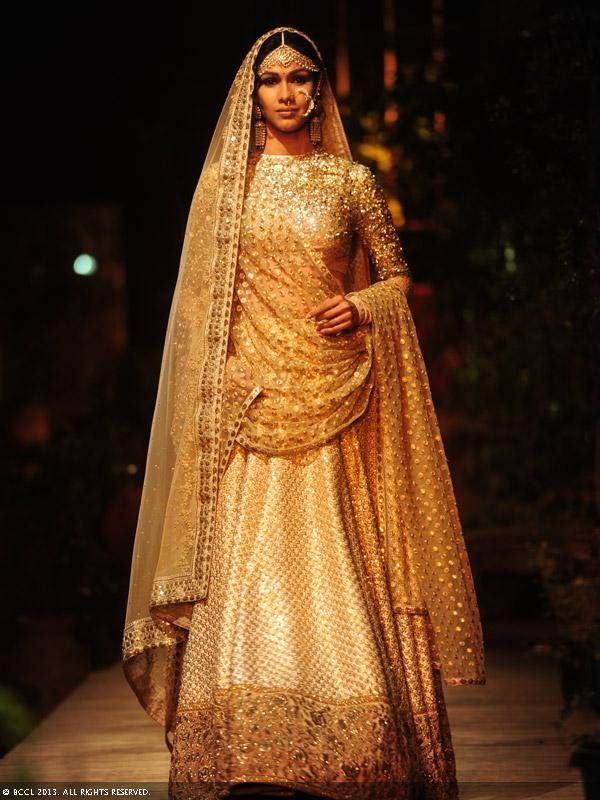 Nethra Raghuraman walks the ramp for designer Sabyasachi on Day 1 of Delhi Couture Week, held in New Delhi, on July 31, 2013.