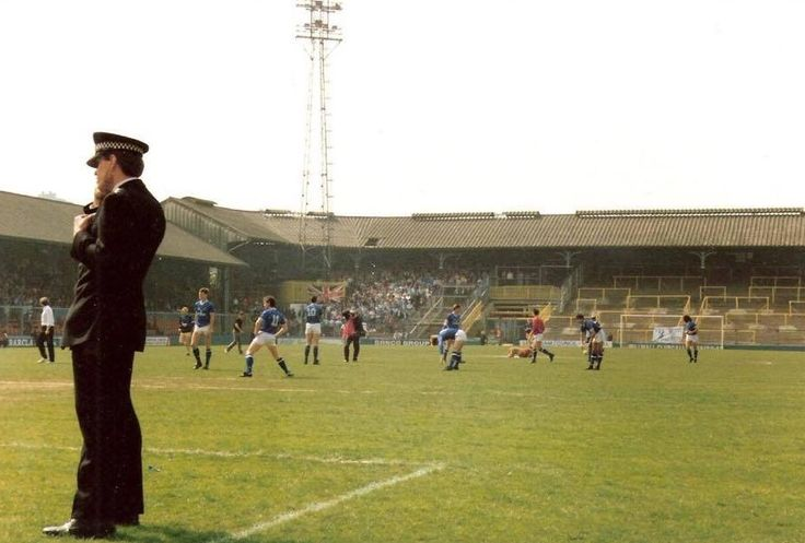 A Poliaceman on the Pitch of Millwall FC the Den at the old place in Ilderton Road South Bermondsey South East London England