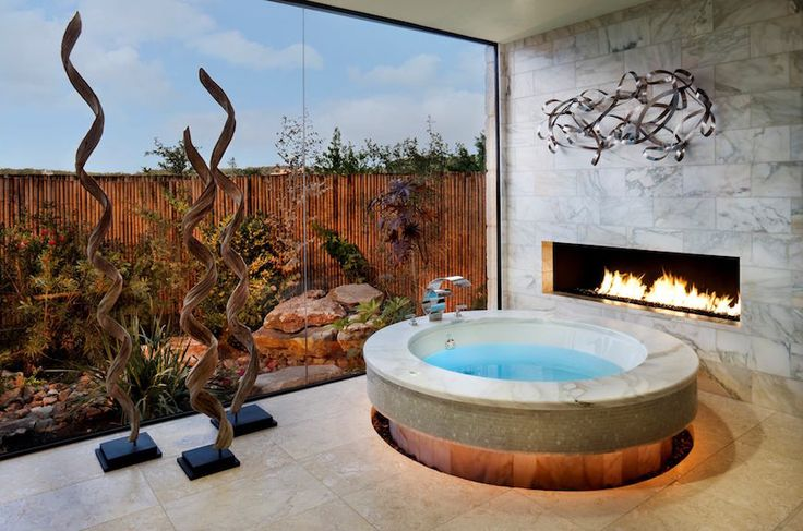 10 Mesmerizing Luxury Bathrooms with Fireplaces That You Will Love ➤ To see more news about Luxury Bathrooms in the world visit us at http://luxurybathrooms.eu/ #bathroom #interiordesign #homedecor @BathroomsLuxury @koket @bocadolobo @delightfulll @brabbu @essentialhomeeu @circudesign @mvalentinabath @luxxu @covethouse_
