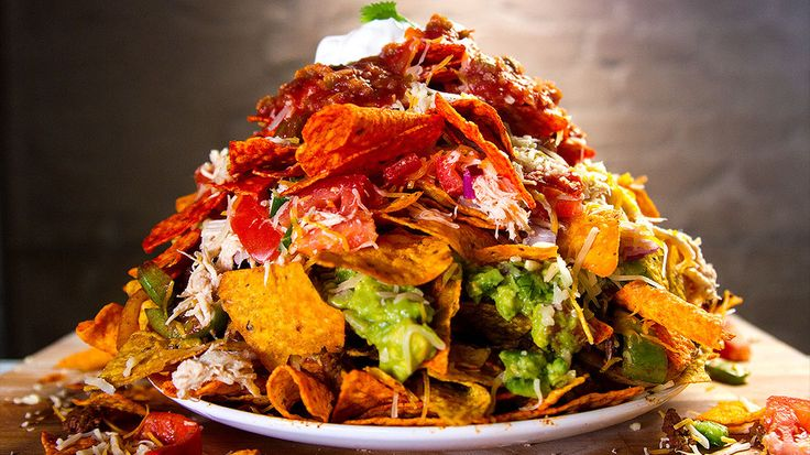 5 Layer Doritos Nachos. Just…say it out loud. Do we really need to convince you to want to make this? Ingredients: 2 Avocados 1 Red Onion 2 Jalapeno Bushel of Cilantro 2 Limes 2 Tomatoes 1 lb. Shredded Chicken 1 lb. Ground Beef Taco Seasoning Fajita Veggies Refried Beans Shredded Cheese Salsa Sour Cream Spicy Nacho Doritos Salsa Verde Doritos Tapatio Doritos Sweet Chili Doritos Nacho Cheese Doritos