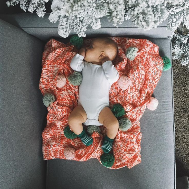 baby and a comfy pom blanket