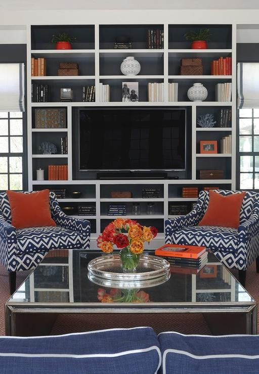 Blue And Orange Living Room Features A Mirrored Waterfall Cocktail Table Pair Of