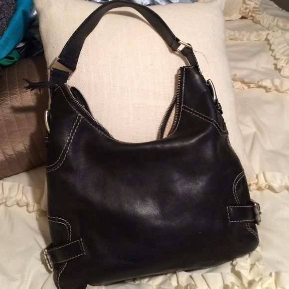 Michael Kors Black Purse Michael Kors black purse with silver buckles. Stain inside. No scratches. Good condition. 9 in by 13 in. Michael Kors Bags Hobos