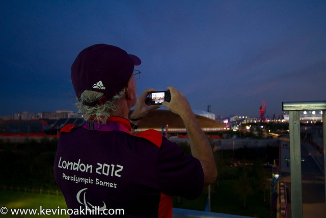 A Gamesmaker enjoys the sunset from Eton Manor, Olympic Park, London 2012 Paralympics by www.kevinoakhill.com, via Flickr