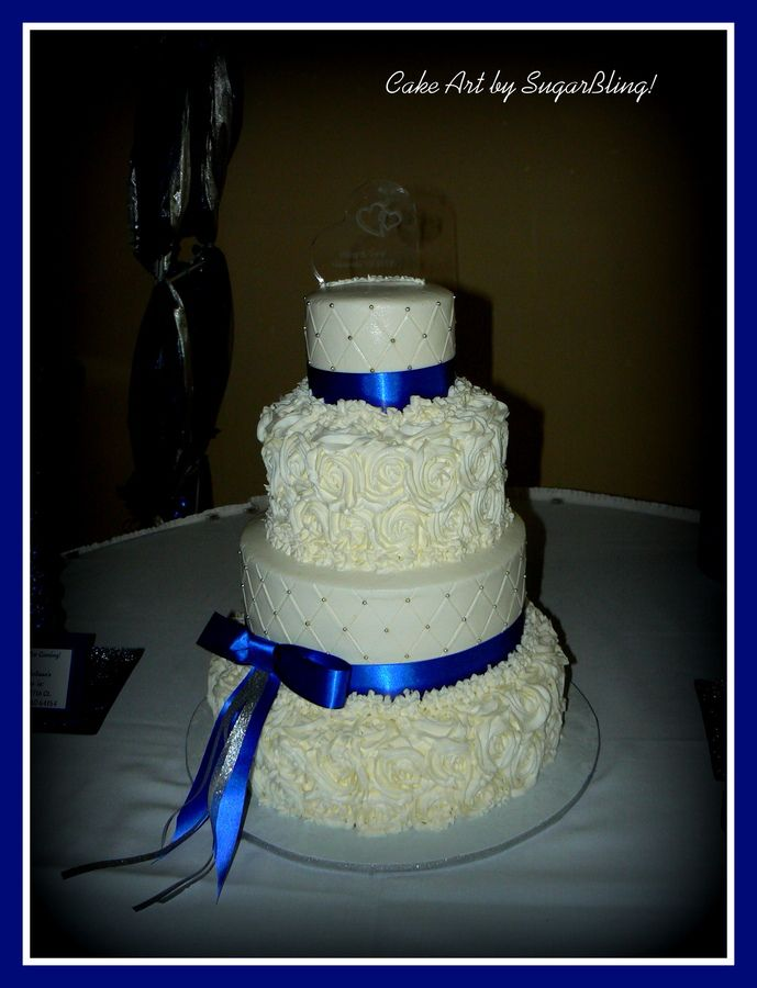 """This is a 5"""", 8"""", 11"""" and 14"""" cake. All buttercream, rosettes and quilte pattern with silver dragees.  Thanks for looking!"""