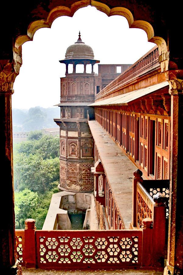 Agra Fort, is a monument, a UNESCO World Heritage site in Agra, Uttar Pradesh, India. It is about 2.5 km northwest of its more famous sister monument, the Taj Mahal. The fort can be more accurately described as a walled city. (built before 1080). Red Fort Agra by ~CitizenFresh - Explore the World, one Country at a Time. http://TravelNerdNici.com