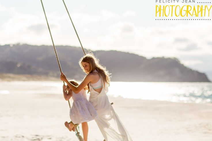 playing on the swing at otama beach such a special spot taken with 85m prime F1.2 lens amazing for portrait photography