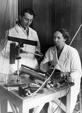 "Frédéric and Irène Joliot-Curie conducting a demonstration of ""artificial radioactivity,"" which they discovered January 1934.  Atomic Heritage Foundation"