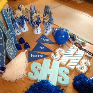 Just finished making the decorations for the main tables at my high school reunion. Yep makes me smile : )