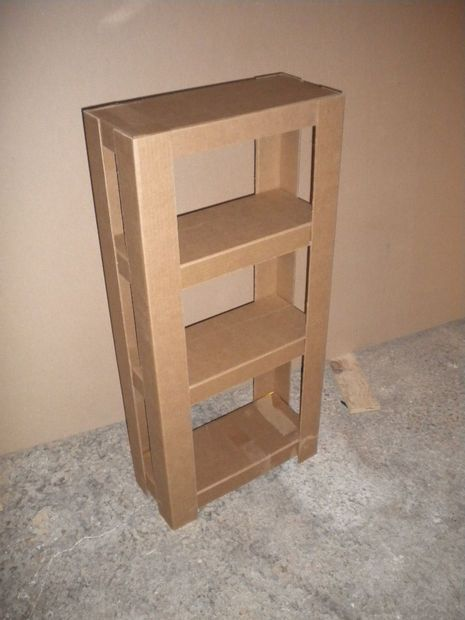 cardboard shelves.  my project for the day.  until i can afford or find wood shelves i will be using cardboard for now!