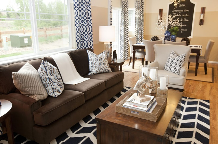 Love the look of this room using natural tones with modern and contemporary patterns... blue chevron rug, print of curtains, chalkboard wall art