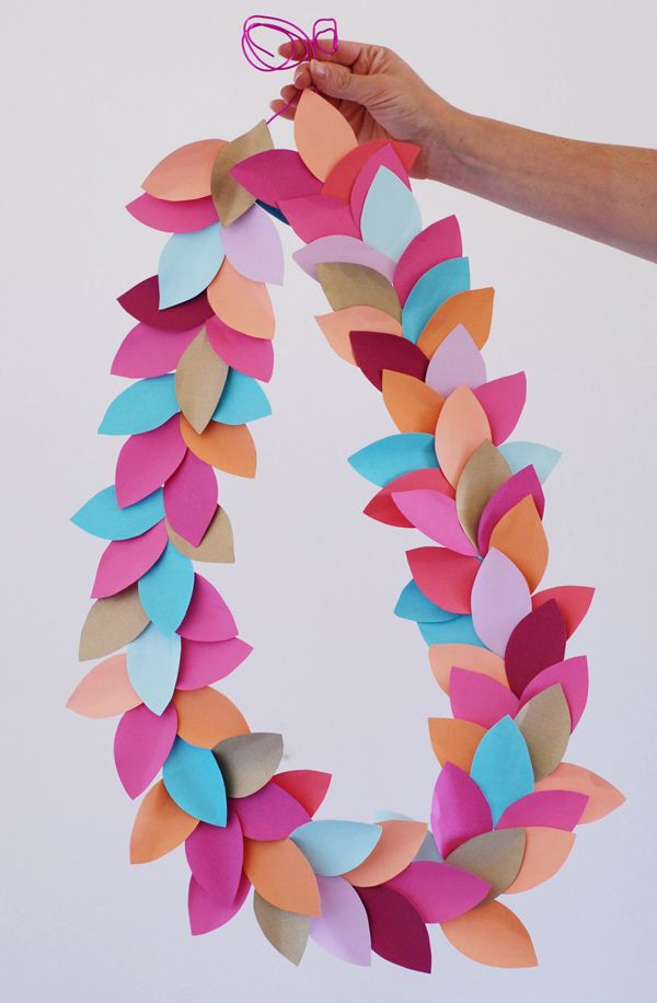 One of my favorite things about paper is how quickly it can turn from a simple crafting supply into a gorgeously festive party statement. This paper leaf party garland is a great example. You can pull one together in under and hour, and it will transform any wall or room with a seasonal spark of festive party style!