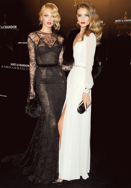 Candice Swanepoel and Rosie Huntington-Whiteley in stunning black and white gowns