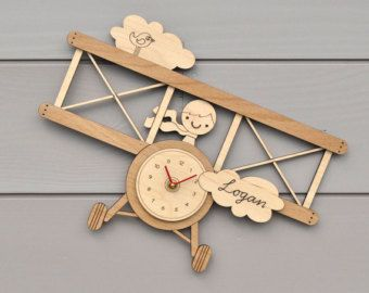 Our sweet Bamboo Crab Clock is a cute wooden kids wall clock and great decor for the ocean baby nursery, nautical theme room or beach home. He is laser cut and engraved from our original Graphic Spaces artwork. He measures 8.5 x 11 and is made from 1/4 amber bamboo. With his ready smile, this crabby fellow is simply the cutest crustacean ever! His quiet clock movement makes him perfect for baby nurseries. White hands and battery are included. So cute!! Our products are all designed, han...