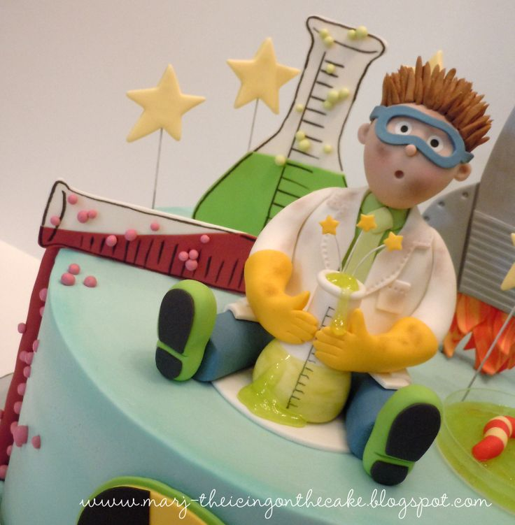 Mad Scientist - Made this cake for a mad science birthday celebration... the kids did experiments and launched rockets.  So fun!  I was really pleased with the way my sugar scientist turned out and the birthday boy loved it too!
