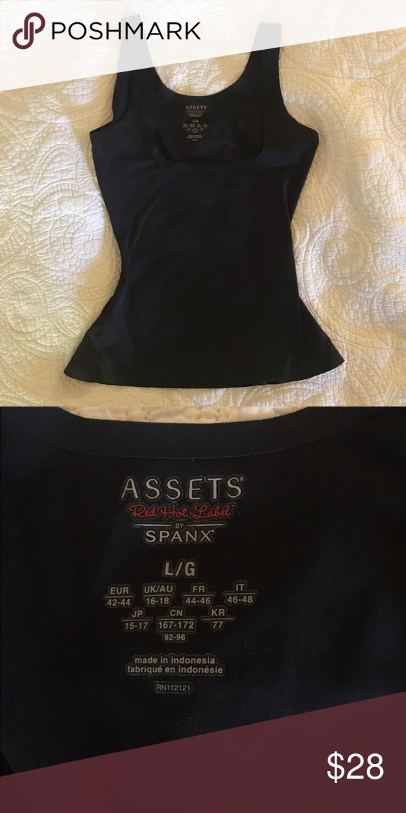 Spanx tank - Assets by spanx. Size large Spanx black tank. Assets by spanx tank. The purpose of this great top Is to tighten your mid section :). The tank is actually made to go under your boobs if you want.  It is tight like a corset and slims the body:). spanx  Other