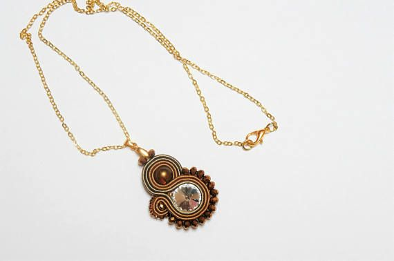 Autumn Necklace, Soutache Necklace, Brown Necklace, Gold Necklace, Dirndl Schmuck, Elegant Small Necklace , Soutache Jewelry, Gold Pendant, Brown Pendant. This beautiful necklace has been made in the Soutache technique with Rayon Soutache, Swarovski beads and Suede. Size: Pendant height: 5 cm (2 Inch) Pendant width: 2.5 cm (1 Inch) Necklace length: 48cm (9,4 Inch)(can be changed) All my jewellery are completely hand-made with precise work. They are one of a kind. All my jewelry are impreg...